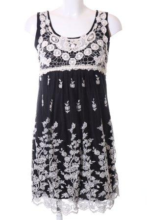Yumi Spitzenkleid schwarz-weiß Blumenmuster Elegant