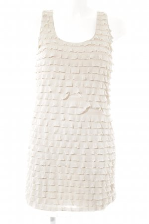 Zara Mini vestido crema look casual
