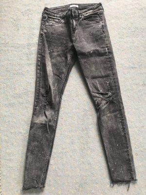 Zara ripped Jeans mit Sprenkeln