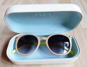 Zara Sonnenbrille mit beigem Rahmen und gelbem Gestell im Case