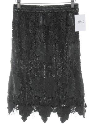 Zara Woman Falda de cuero negro estampado floral elegante