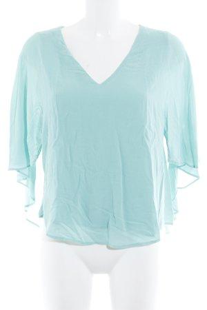 Zara Woman Camisa con cuello V turquesa look casual