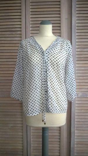 Zarte weiße Bluse mit schwarzen Punkten