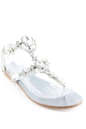 Sandalias de tacón con talón descubierto color plata look casual