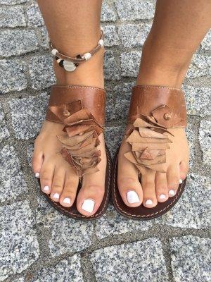 Zehensandalen, flip flops