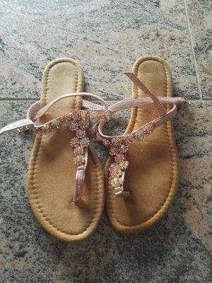Sandalias con talón descubierto color rosa dorado