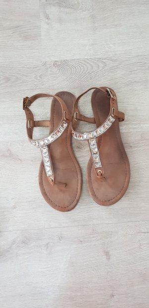 Zehentrenner- Sandale