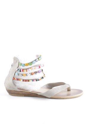 Sandalo toe-post grigio chiaro stile hippie