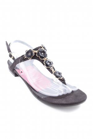 Sandalo toe-post nero-oro motivo floreale stile da moda di strada