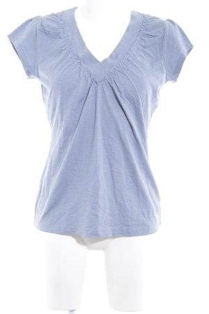 Zero Camiseta azul celeste look casual
