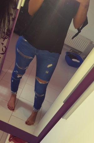 Zerrissene Jeanshosen