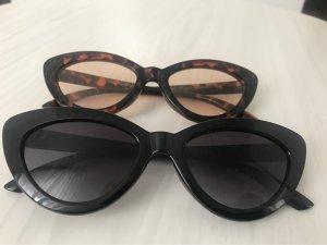 Zwei Cateye Sonnenbrillen