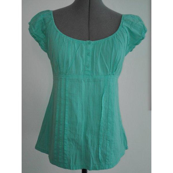 Eine schöne Sommer Bluse in blasstürkis Farbe,aus 100% Baumwolle.
