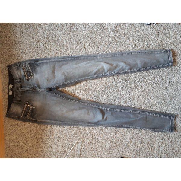 Graue Jeans mit Reißverschlüssen