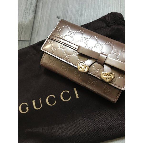 Gucci Schlüsseletui in Leder Rose mit Schleife und Herzen 299€