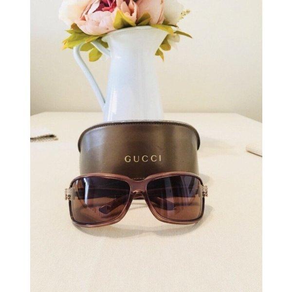 Gucci Sonnenbrille mit Strasssteinen.
