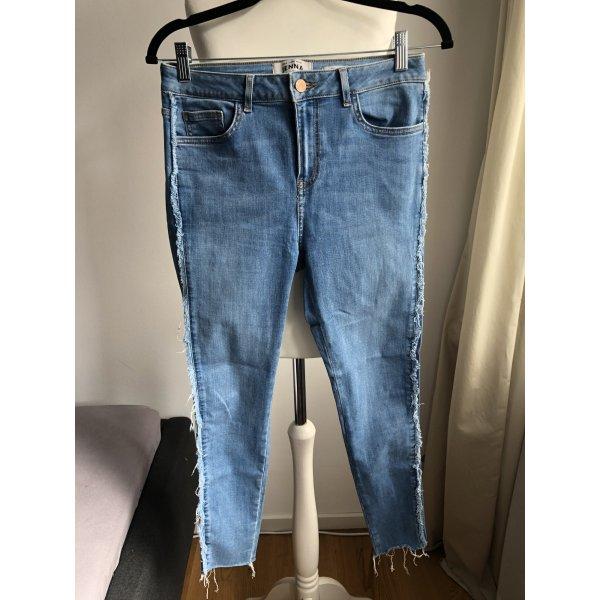 Jeanshose mit seitlichen Franseln   Blau