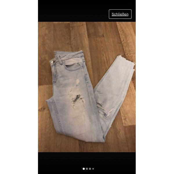 Lockere ripped / used Look Jeans von zara