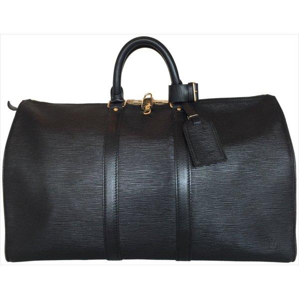 Louis Vuitton Reistas zwart-goud Leer