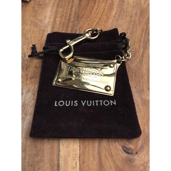 Louis Vuitton Schlüsselanhänger goldfarbende Metallplatte mit LV Adresse in Paris