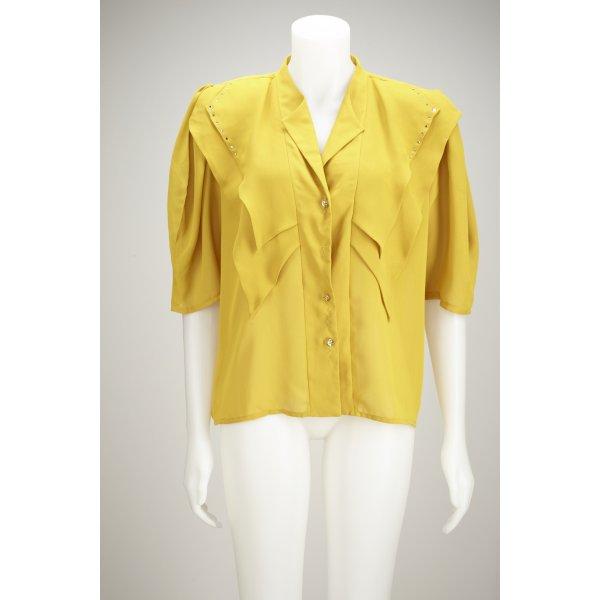 Power-Shoulder Bluse in Senfgelb mit Goldknöpfen und Glitzerapplikationen