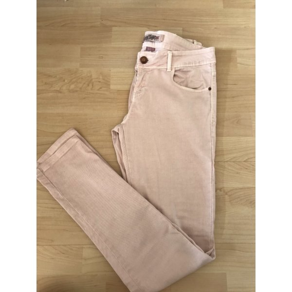 Rose farbene Jeans