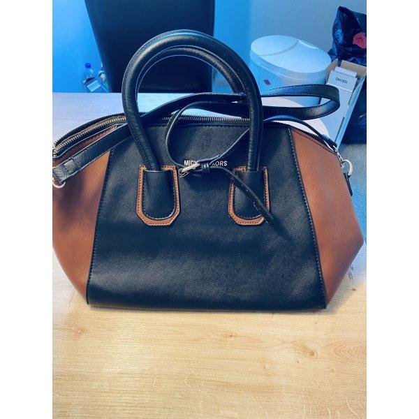 Schwarze Handtasche mit braunen Seitenteilen