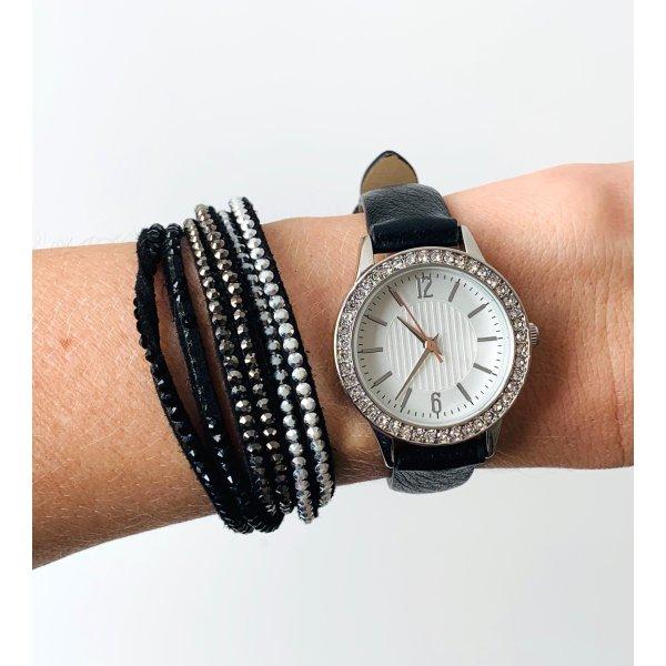 Schwarze Leder Armbanduhr weißes Ziffernblatt Strasssteine