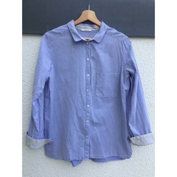 Tolle Bluse mit dekorativem Saum