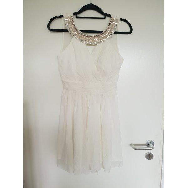 Weißes Kleid mit Applikationen